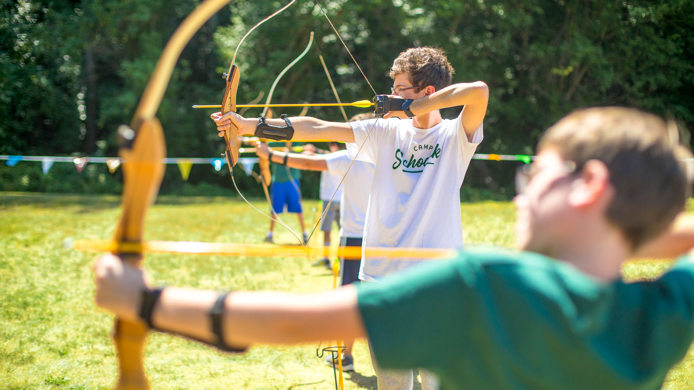 Boys doing archery at summer camp