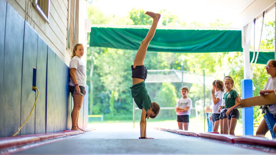 Camper does handstand during gymnastics