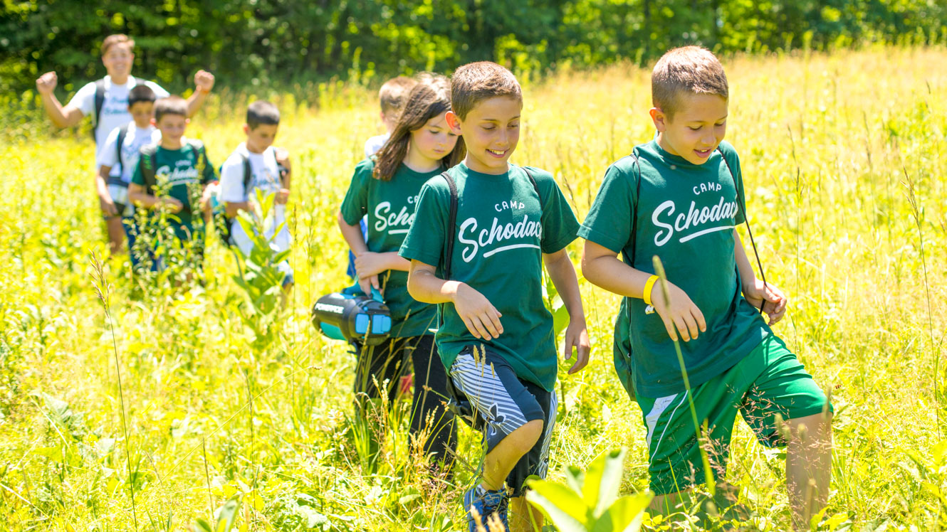 Group of young campers goes for a day hike