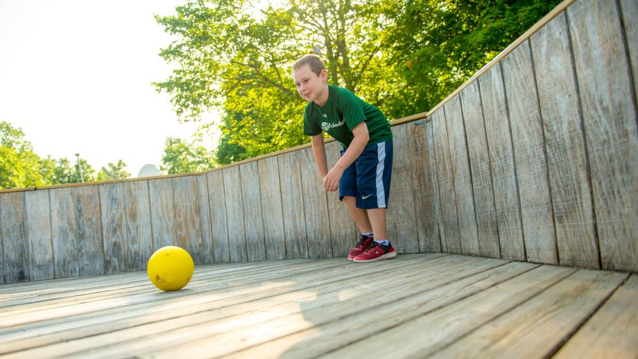 Boy plays GaGa at summer camp