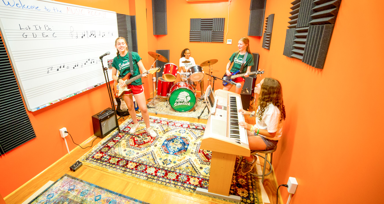 Girls practice music at summer camp