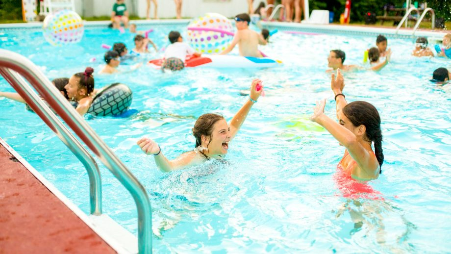 Girls have a pool party at summer camp