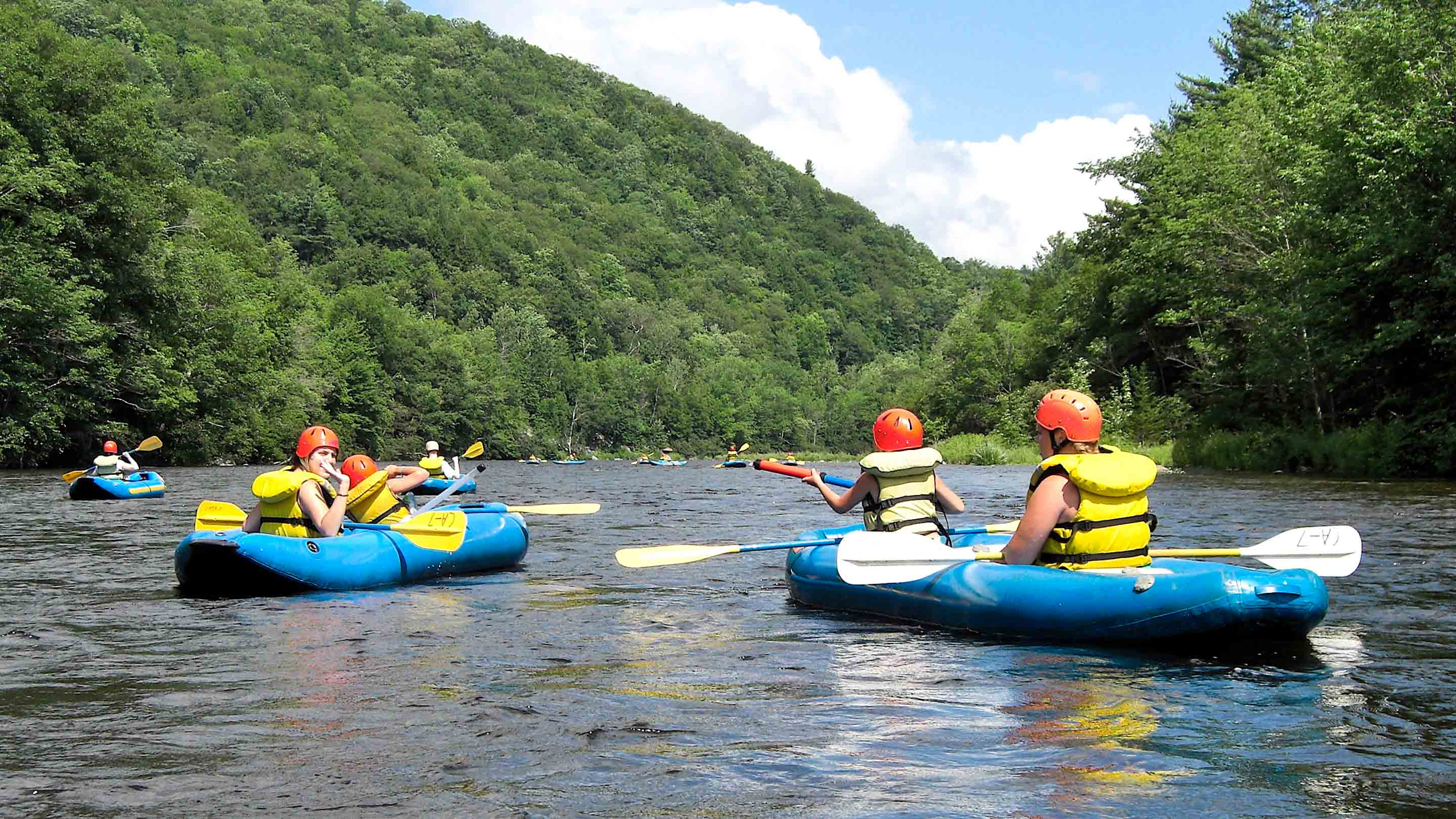 Campers kayaking on rafting trip