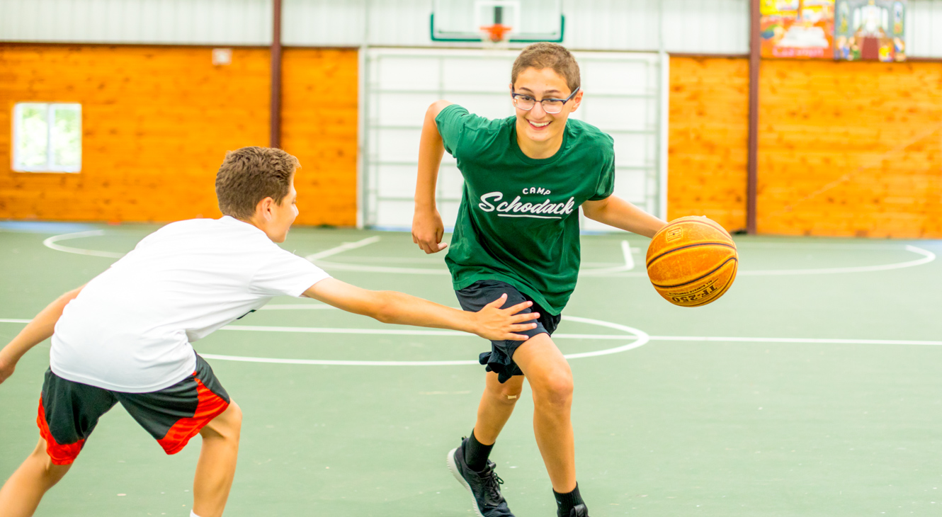 Campers play basketball in Schodack's gym