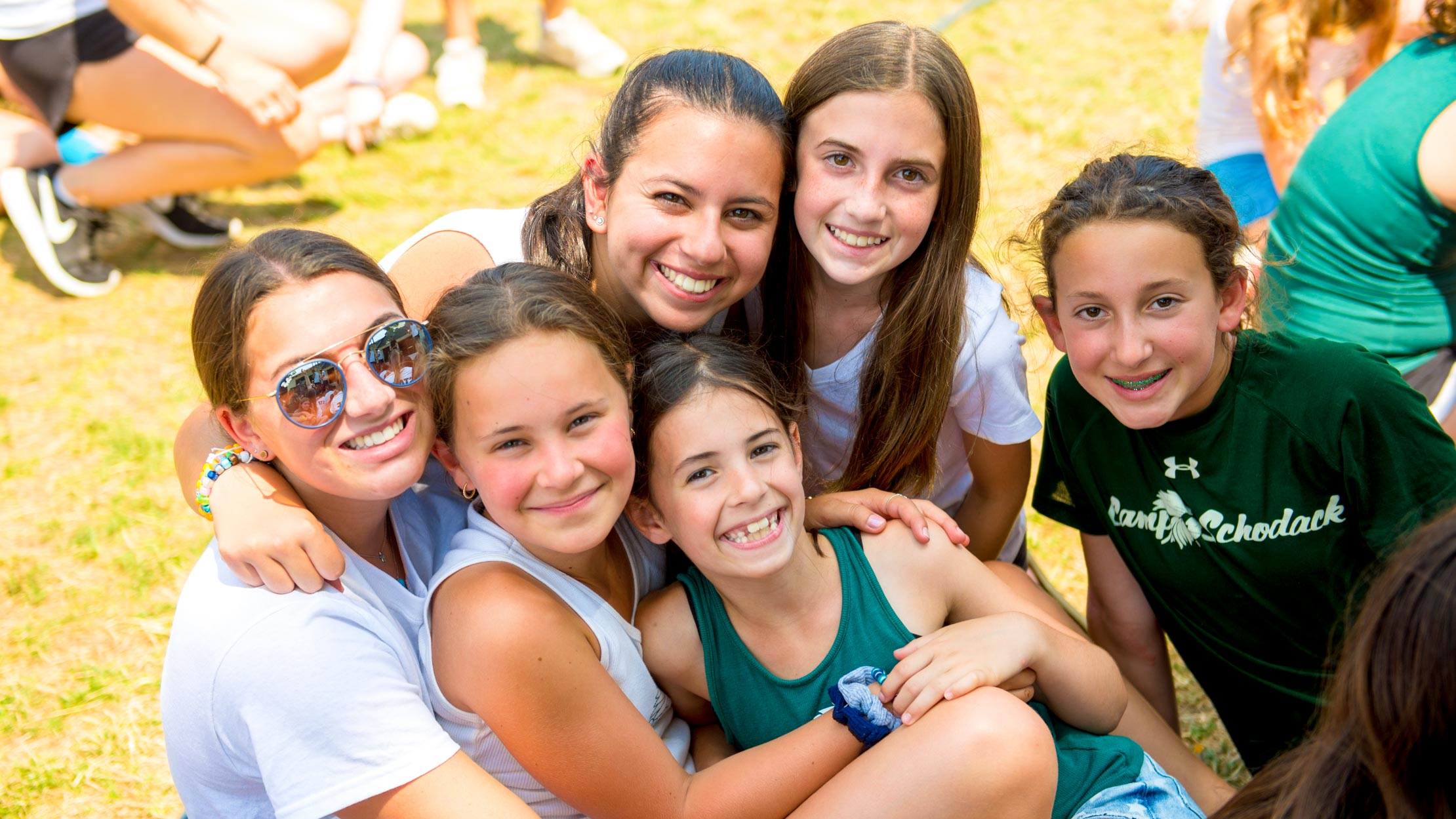 Campers and counselor group hug at summer camp