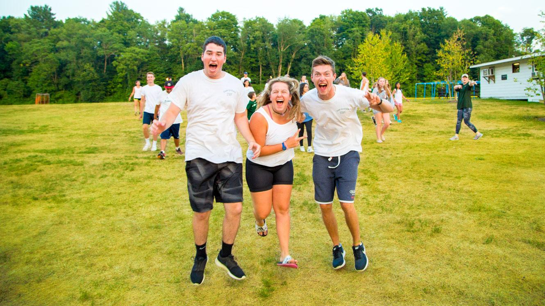 Staff members running across field